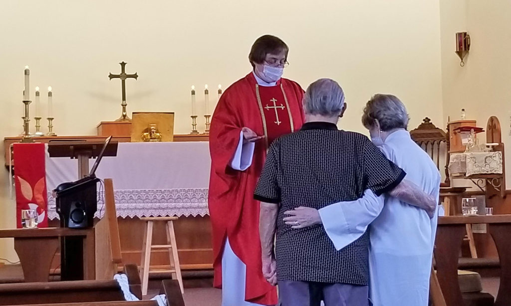 Couple receiving anniversary blessing